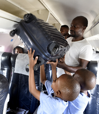 A father and his boys get ready for their fastjet flight. Captured by Nicolina Simoes.